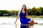 Senior Portrait girl sitting at lake