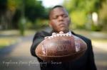 Senior Portrait boy holding football