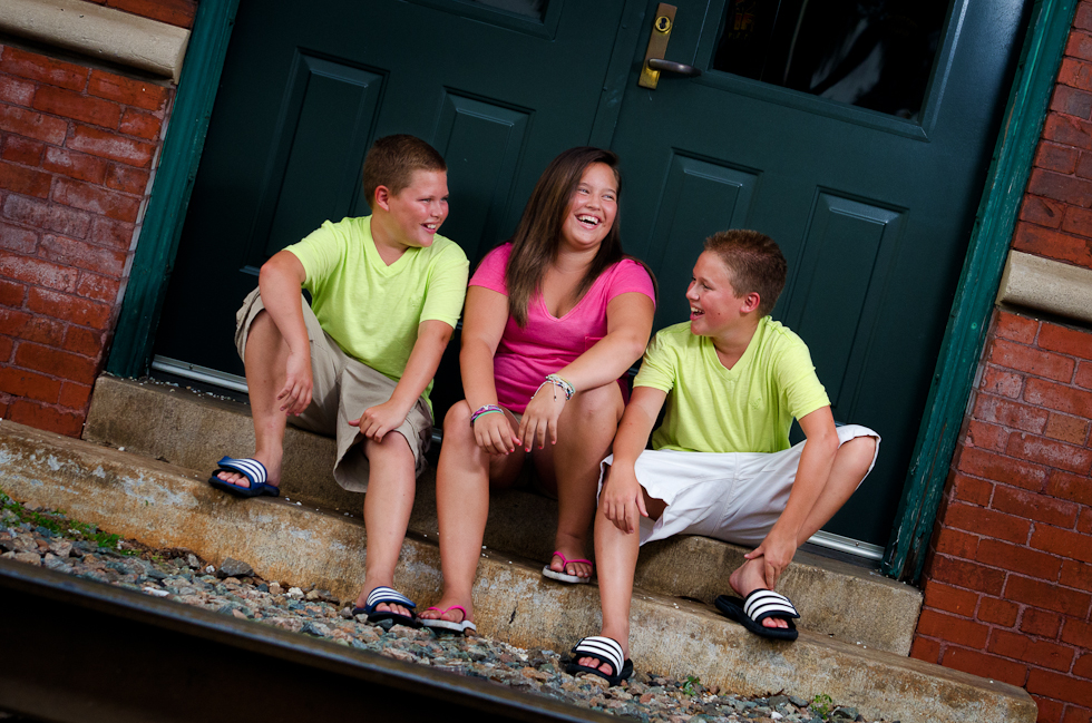 triplets laughing on steps train depot Plant City
