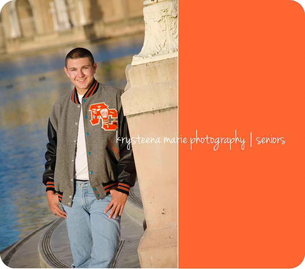 senior portrait guy in letter jacket at lake plant city