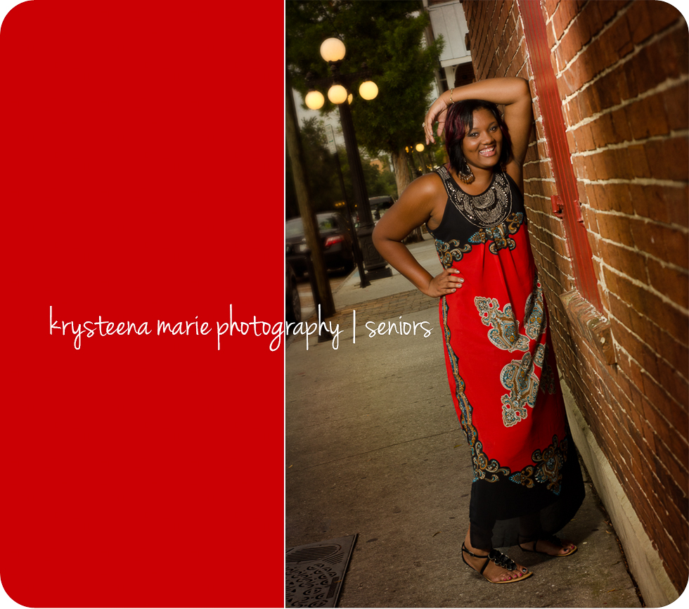high school senior portraits girl in red dress against brick wall