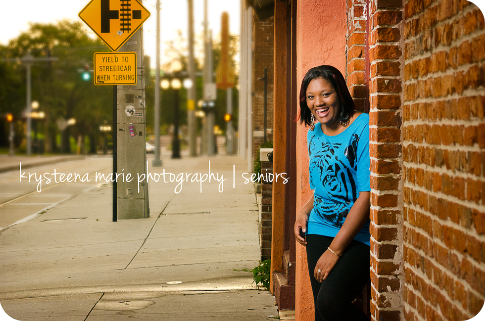 high school senior girl street car crossing sign ybor city
