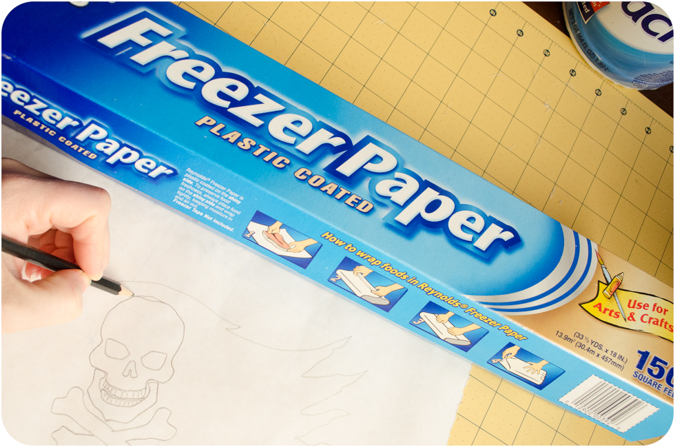 Drawing pirate flag on freezer paper with pencil