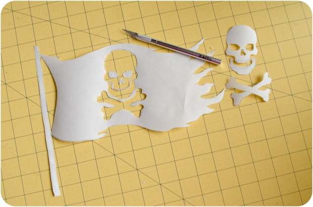 Completed freezer paper stencil jolly roger pirate flag with x-acto knife