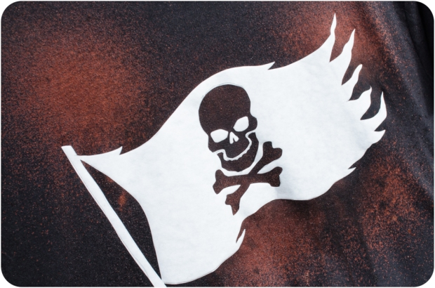 Close up of pirate stencil bleach spray DIY tee shirt